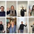 Eight men and women raising one hand.